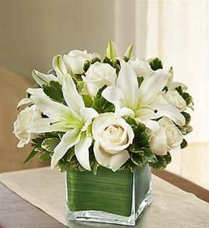 4f517149d9827928b77d3e4c78e0892b-white-flower-arrangements-centerpiece-flowers